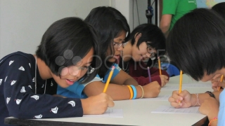 Asian Students Writing English Exam. Stock Footage