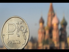 Oil Price Slide and Sanctions Cost Russia $140bn